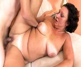 Horny granny with big tits fucks the hell out of young boy